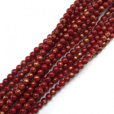 Jadeit czerwony ze złotym kulka 6mm gładka